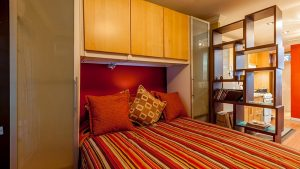 sleeping quarters in studio vacation rental - choose to be happy