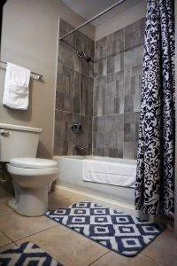 tiled bathroom in a vacation rental - choose to be happy
