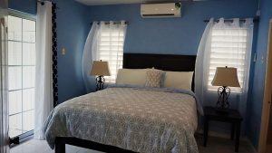 contemporary bedroom in vacation rental - choose to be happy