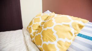 bed pillows in vacation room - choose to be happy