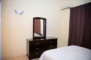 dresser in corporate rat apartment rental - choose to be happy