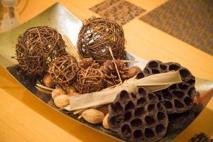 decorative tray of pine cones - choose to be happy