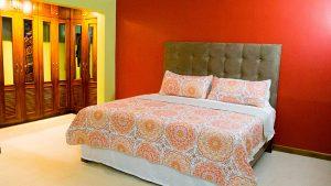 queen bed in bedroom - choose to be happy