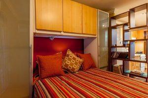 sleeping quarters in studio vacation rental - choose to be happy